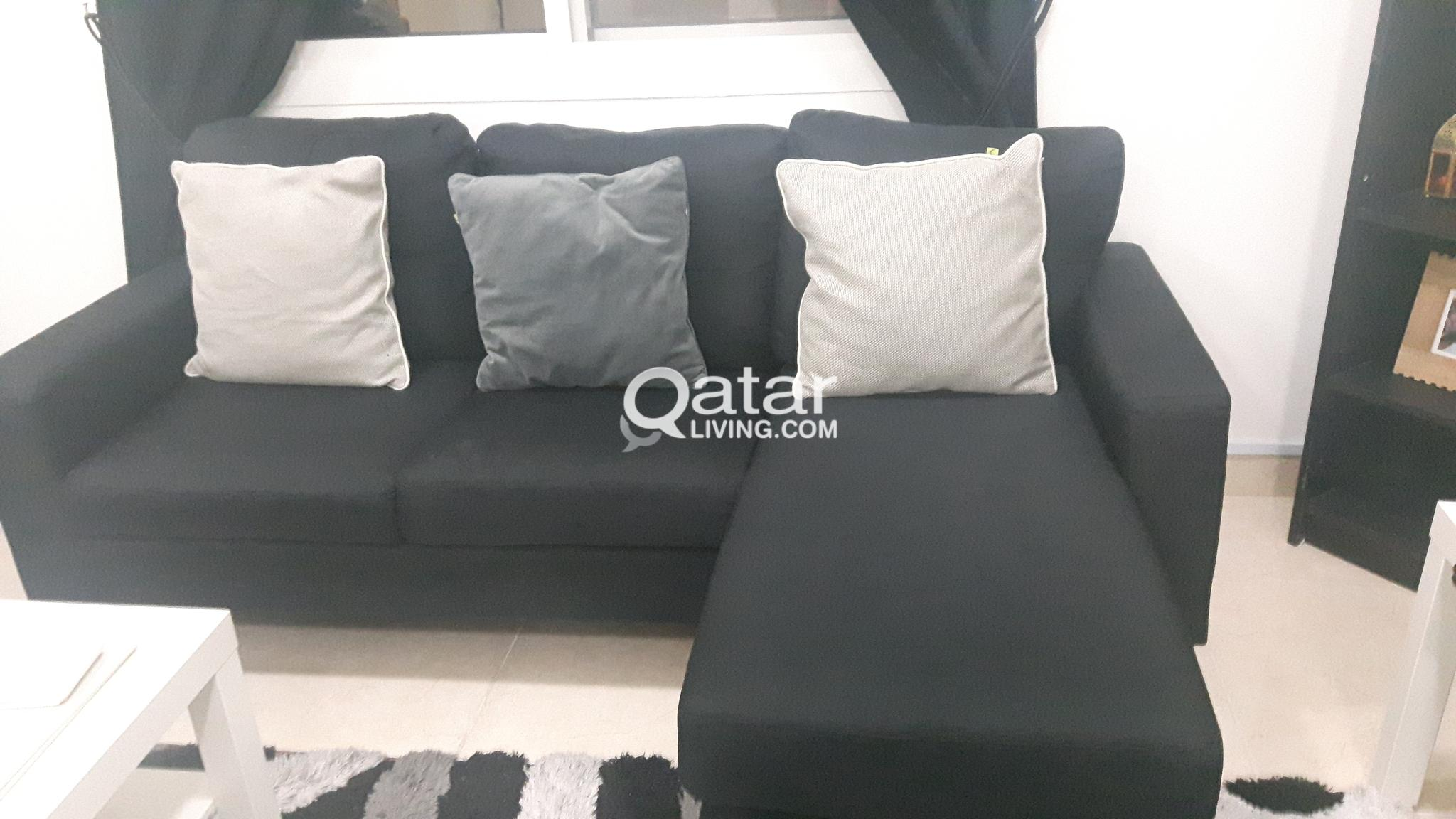 2  black sofas with free cushions or buy single so