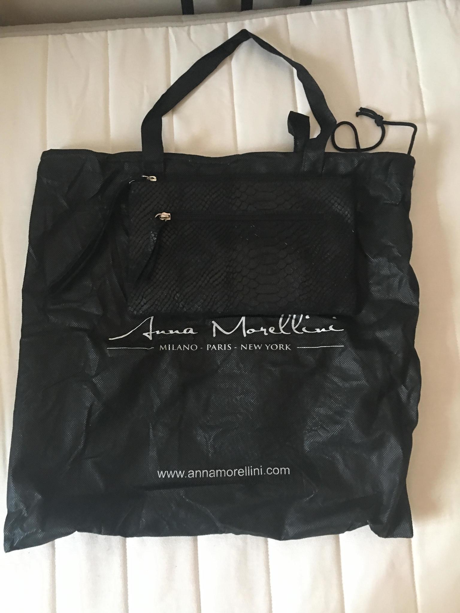 Brand New Italian soft eather clutch bag