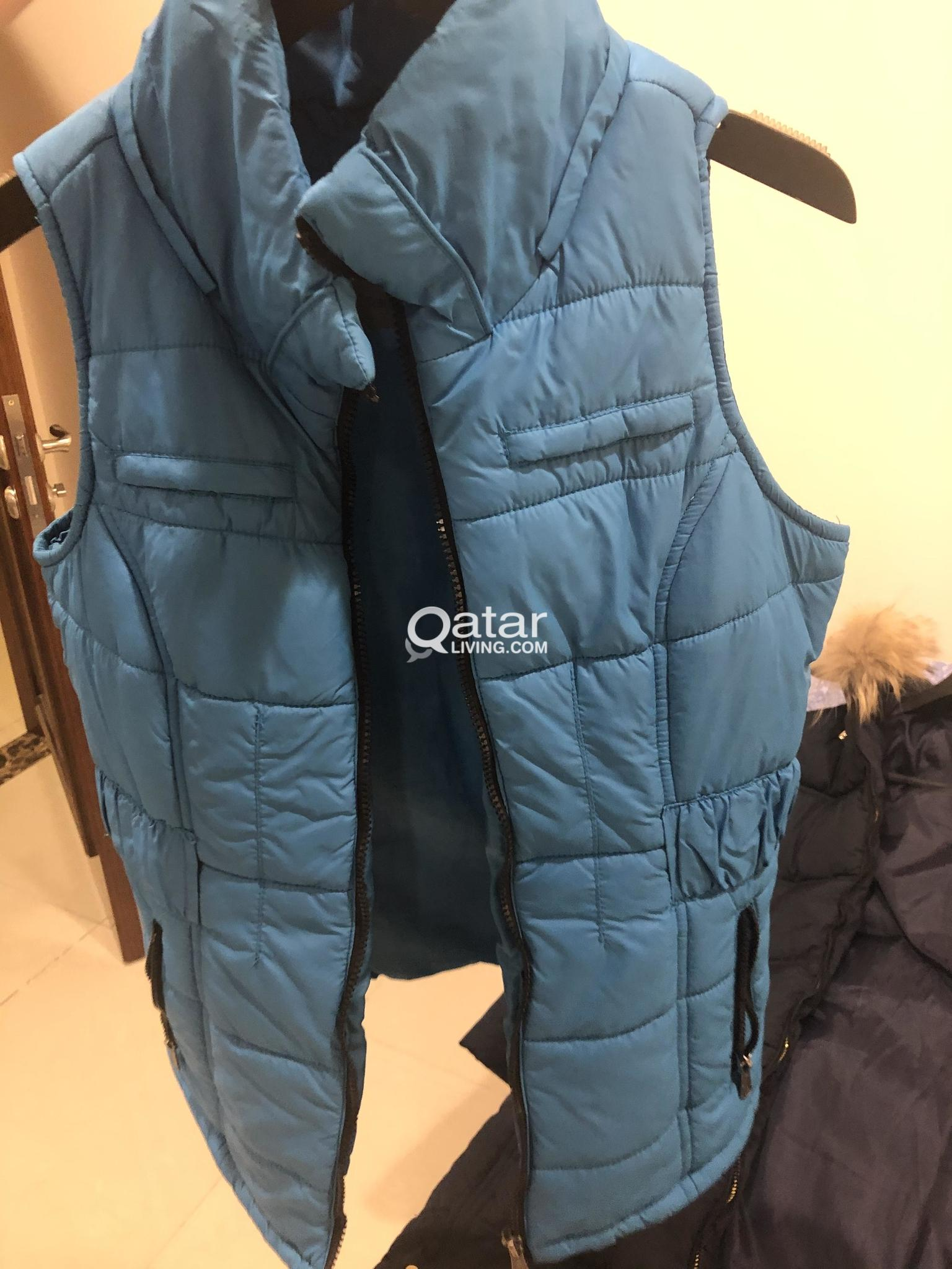 Blue long winter coat and light blue jacket with h