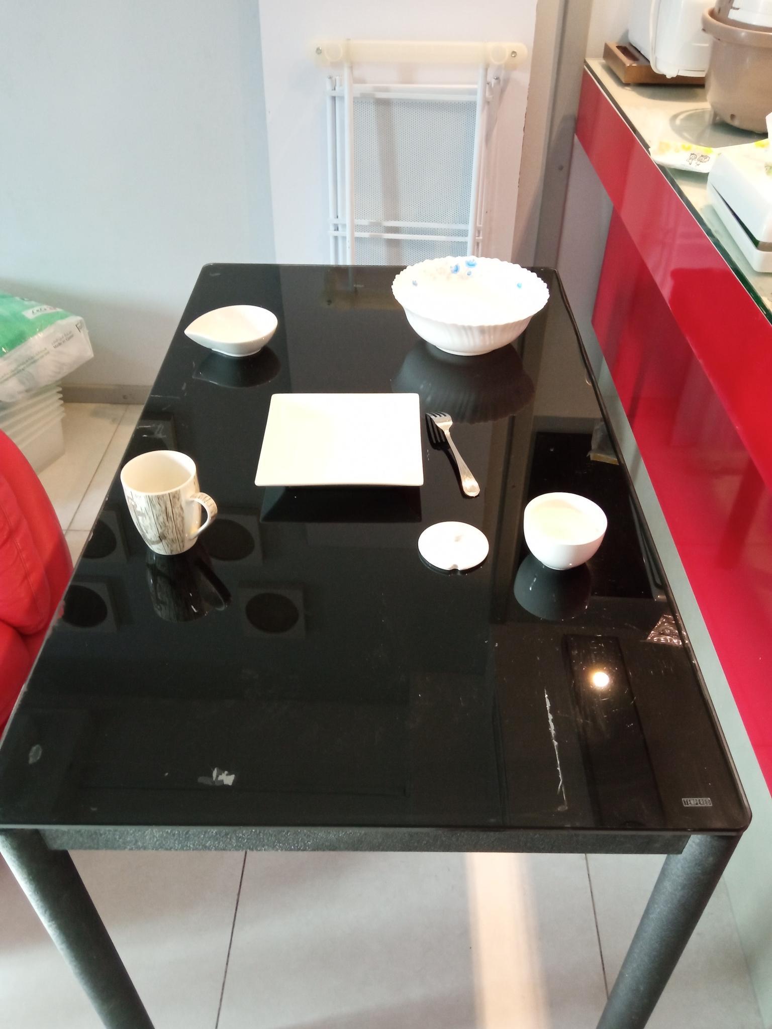 kitchen table.  iron legs, durable glass top.  Siz