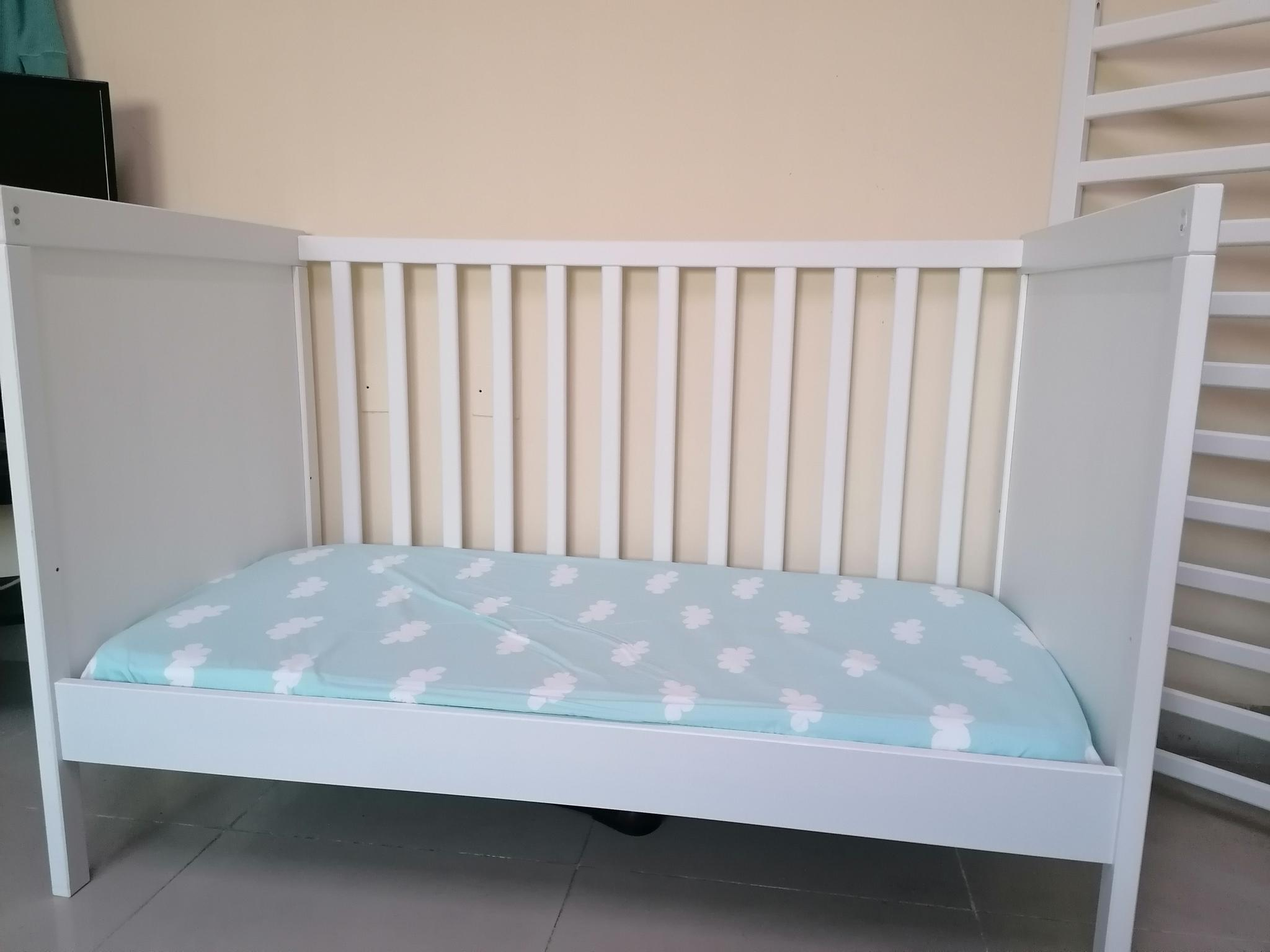 Ikea Cot Bed (very excellent condition). Almost ne