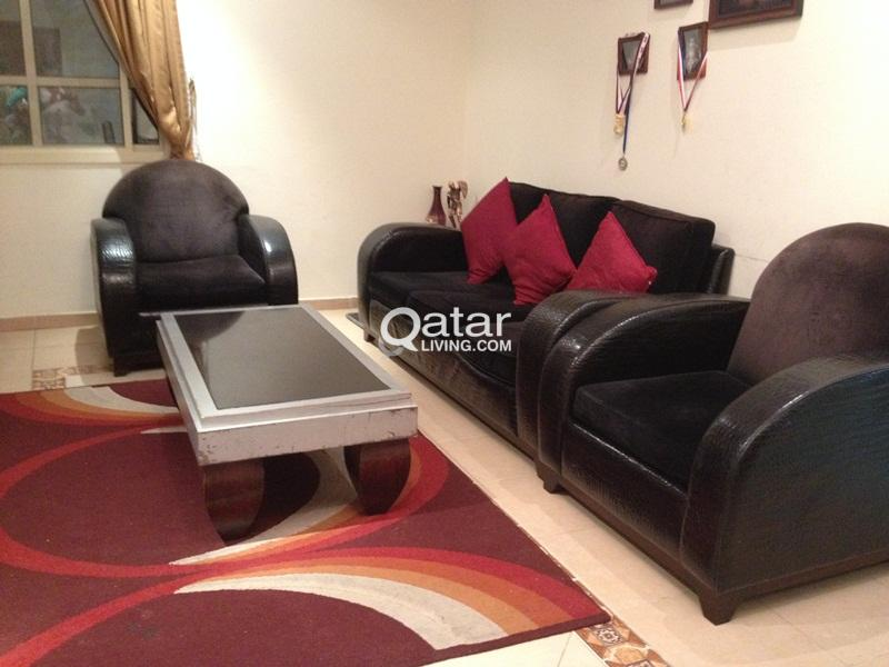 Expensive Black leather sofa set with marble top t